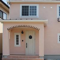 淡いピンクのかわいい家